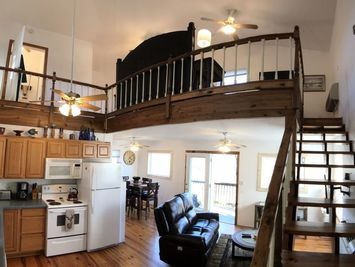 Beaver Lake Haven vacation rental shows an overview of the Upper Loft Unit. This is a couple's ideal getaway place in Arkansas.